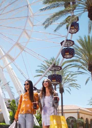 Irvine Spectrum Giant Wheel Turning Behind Two Women