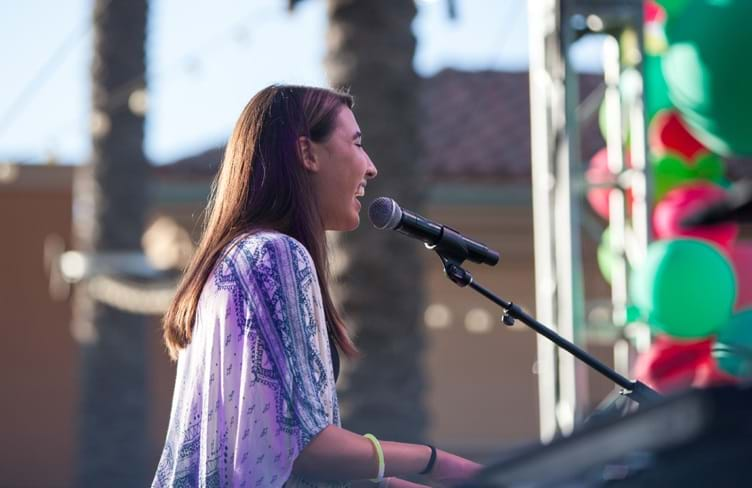 Hanna Eyre performing at Irvine Spectrum Center