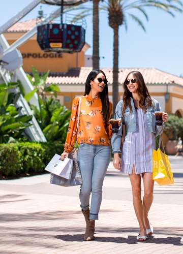 Two women shopping at Irvine Spectrum Center in front of Anthropologie